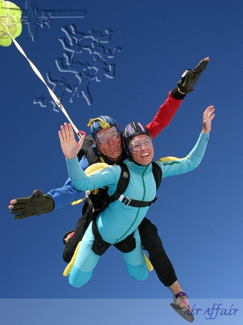 Instructor Clem skydiving with passenger Annette - looks like he's having a ball again!