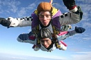 Mike jumping over Kent with tandem passenger Rachel Rodriguez.